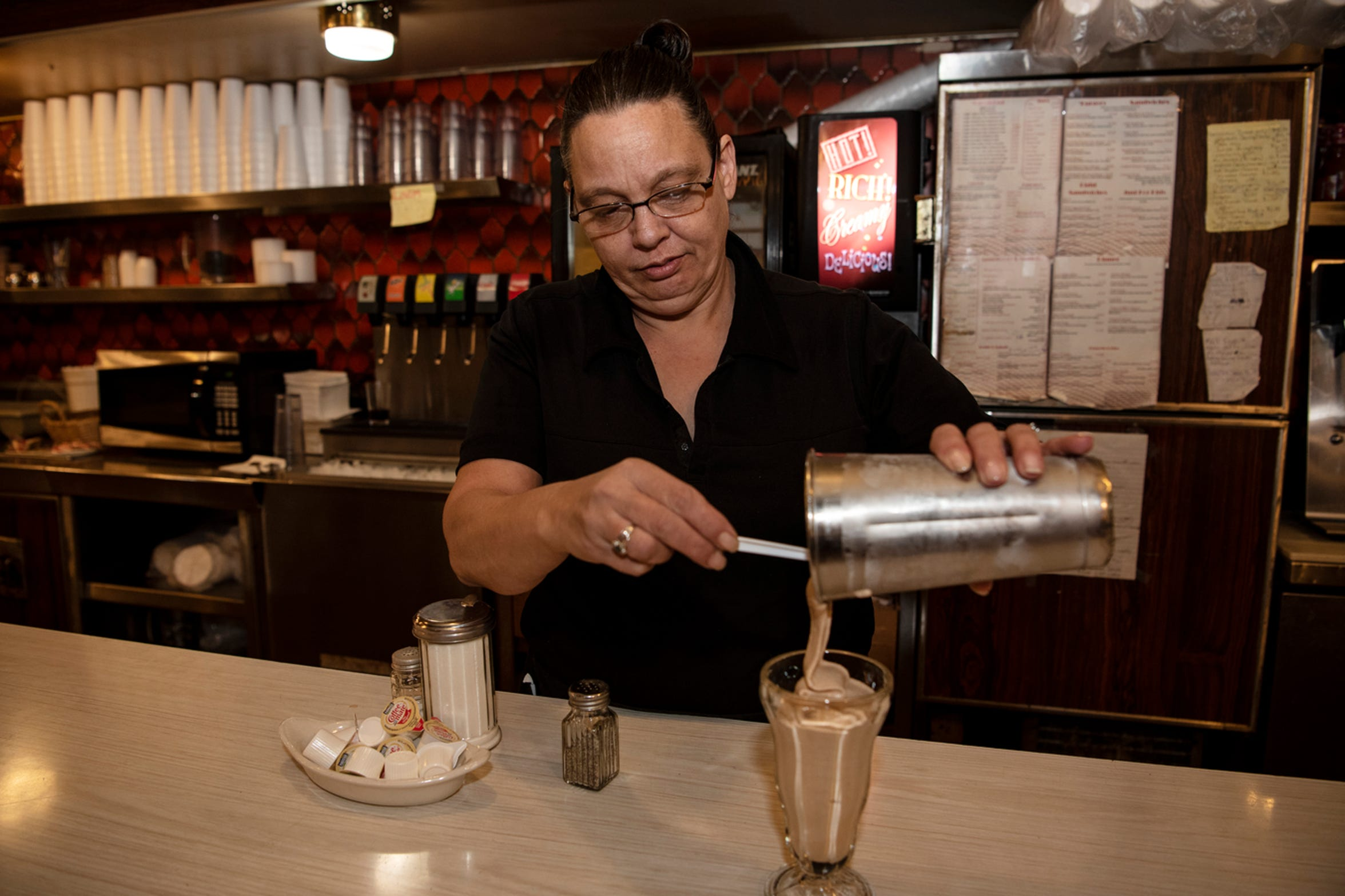 Cheryl Smith prepares a chocolate malt on Wednesday, Nov. 20, 2019 at Speed's Koffee Shop in Battle Creek, Mich.