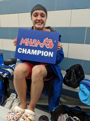 Harper Creek's Alysa Wager celebrates winning two state titles in swimming on Saturday.