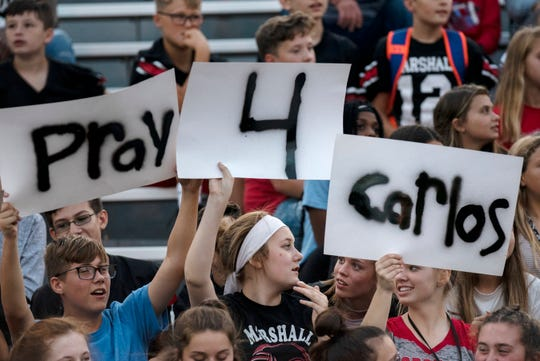 Marshall students show support for their freshman classmate Carlos Sanchez on Friday, Sept. 13, 2019 during a game against Pennfield at Marshall High School. Carlos has recently been diagnosed with leukemia.