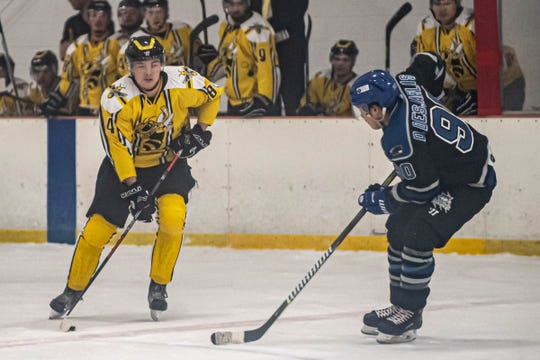 Rumble Bees Carl Mansson (84) advances the puck against  Watertown Wolves Lane King (9) in action earlier this season.