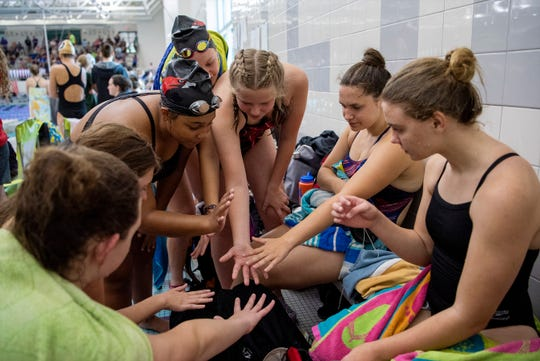 Marshall swimmers prepare for a swim meet on Saturday, Aug. 24, 2019 at Lakeview High School.