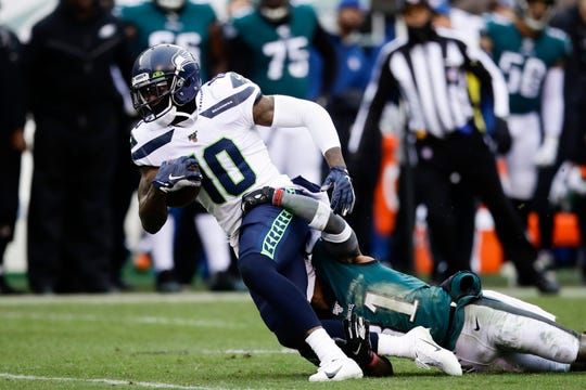 Seattle Seahawks' Josh Gordon (10) is tackled by Philadelphia Eagles' Jalen Mills (31) during the first half of an NFL football game, Sunday, Nov. 24, 2019, in Philadelphia. (AP Photo/Matt Rourke)