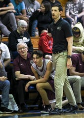 Astronaut basketball head coach Kyle Gilreath and his father Larry watch the action during Wednesday's game in Titusville.