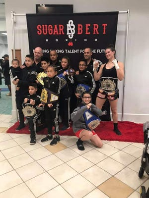 Palm Bay ROUND13 Boxing had seven boxers take first-place national championships at the SugarBert National Championships in Kissimmee.