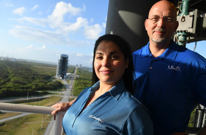 Dane Drefke, Mechanical Operations Lead Engineer for United Launch Alliance at Launch Complex 41, and Melanie Weber, Boeing Launch Pad Lead, stand on the Crew Access Arm at the pad.