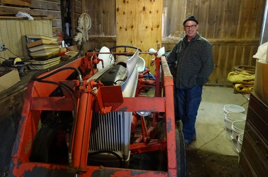 Tony Horning of Emmanuel's Bread shows off the organization's newly purchased 1950s-era tractor.