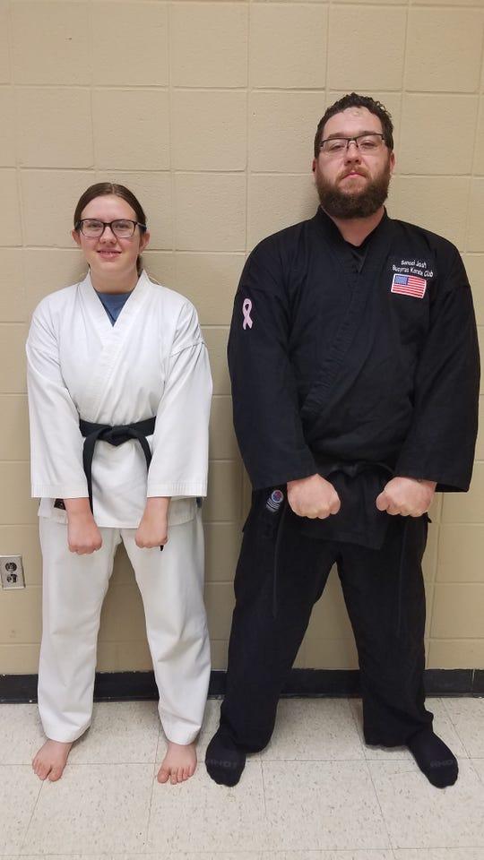 Emma Pahl and Joshua Adams recently achieved the rank of black belt in Shotokan.