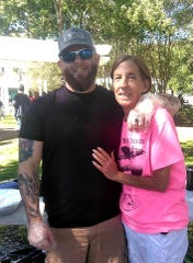 Laurie Lee Yates and her son Seth Christian at a weekly Sunday Tacos Not Bombs lunch for the homeless at Artesian Park, where mom and son volunteer.