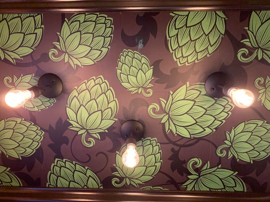 Hops 'grow' on the ceiling in the foyer of the home of Kings Road Brewing Company in Haddonfield.