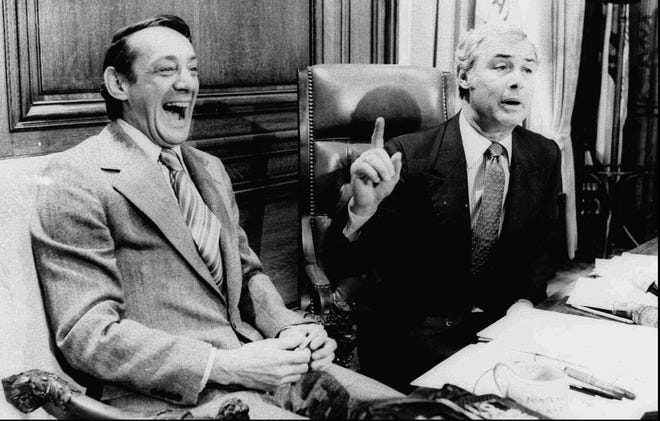 San Francisco Supervisor Harvey Milk, left, and Mayor George Moscone are shown in April 1977 in the mayor's office during the signing of the city's gay rights bill. Milk and Moscone were both shot dead inside City Hall Nov. 27, 1978.