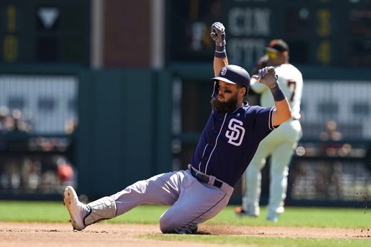 Sep 1, 2019; San Francisco, CA, USA; San Diego Padres left fielder Nick Martini (2) slides into second base on a double during the first inning against the San Francisco Giants at Oracle Park.