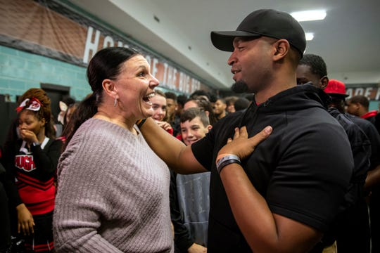 Hughes football coach Chris Mobley thanks Dana Gendreau for all she has done for his team, after Good Morning America surprised Gendreau at Hughes STEM High School in Clifton on Monday, November 25, 2019. After reading an article in The Enquirer, Gendreau connected with Hughes football coach Chris Mobley when she read that his athletes didn't get enough to eat.