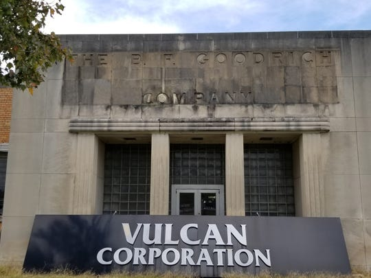 "The nameplate for ""The B.F. Goodrich Company"" was discovered beneath the Vulcan Corporation building sign during demolition over the weekend."
