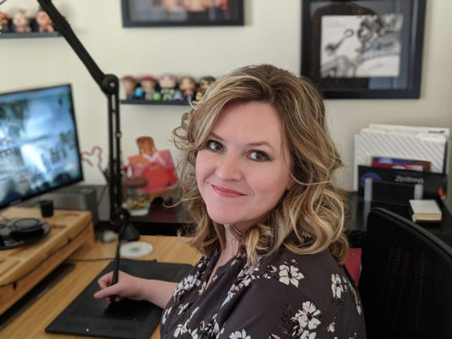 """Senior matte painter Heather Abels works at her Clarksville home office. She worked as set extension artist on """"Frozen II,"""" which hit theaters nationwide on Nov. 22."""