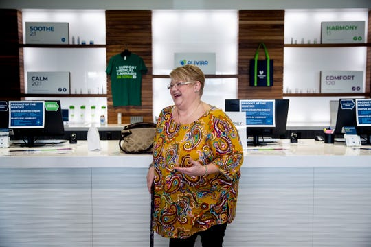 Wendy Shoemaker, 51, purchases medical marijuana products from MedPharm's dispensary in Windsor Heights on Nov. 25. Dec. 1 marks the one-year anniversary of being able to purchase medical marijuana products in Iowa.