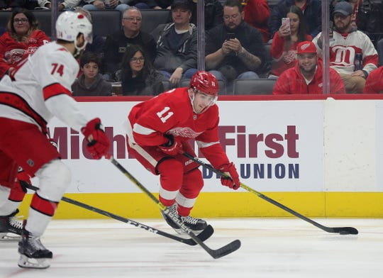 Latest Sports News: Red Wings right wing Filip Zadina skates against Hurricanes defenseman Jaccob Slavin during the first period of the Wings' 2-0 loss on Sunday, Nov. 24, 2019, at Little Caesars Arena.