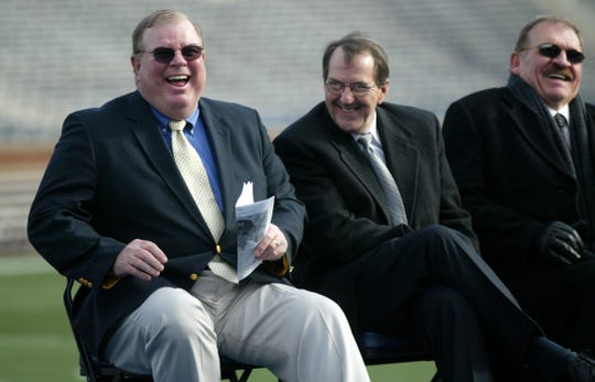 Jim Brandstatter, Lloyd Carr and Dan Dierdorf laugh as they listen during the Celebration of Bo's Life service, on Tuesday,  Nov. 21, 2006 in Ann Arbor at Michigan Stadium. The service was for former legendary University of Michigan Bo Schembechler.