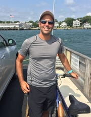 John Fischetti has been working with Lincoln to get issues resolved involving his new 2020 Aviator SUV. He is pictured here in the summer of 2018 on the Chappaquiddick Island ferry on Martha's Vineyard as part of an island bike tour with his son.