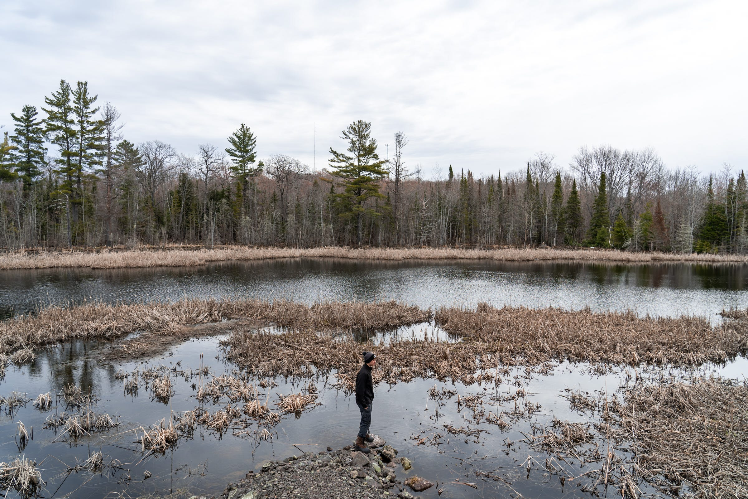 Elm River Township School student Daniel Bramble, 15, looks over a pond during recess on Wednesday, May 8, 2019 in Elm River Township in Michigan's Upper Peninsula.
