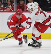 Latest Sports News: Red Wings right wing Filip Zadina goes for then puck against Hurricanes center Lucas Wallmark during the third period of the Wings' 2-0 loss on Sunday, Nov. 24, 2019, at Little Caesars Arena.