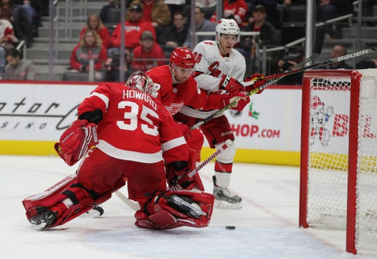 Wings goaltender Jimmy Howard can't get to this shot by the Hurricanes during the second period Sunday at LCA.