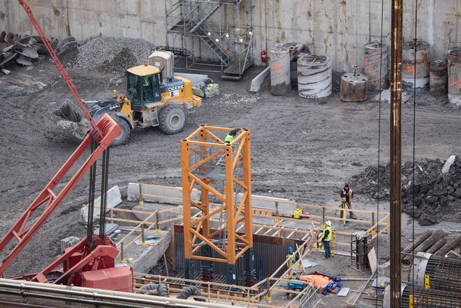 Workers at the Hudson's Site begin to build a tower crane Monday Nov. 25, 2019.