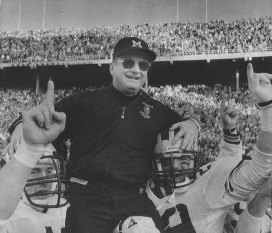 Michigan coach Bo Schembechler is carried from the field Saturday, November 22, 1986 after a 26-24 victory over Ohio State for the Big Ten title. The moment came 17 years to the day after he first beat the Buckeyes in one of the greatest upsets in college football history.