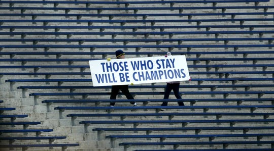 Children carry a sign of Bo Schembechler's famous motto during the Celebration of Bo's Life service, on Tuesday,  Nov. 21, 2006 in Ann Arbor at Michigan Stadium. The service was for former legendary University of Michigan Bo Schembechler.