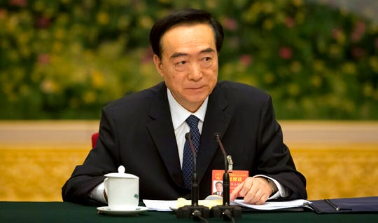 In this file photo taken Tuesday, March 12, 2019, Chen Quanguo, Communist Party secretary of China's Xinjiang Uighur Autonomous Region, attends a group discussion meeting on the sidelines of China's National People's Congress (NPC) at the Great Hall of the People in Beijing.
