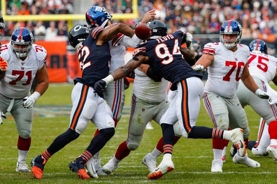 Chicago Bears outside linebacker Khalil Mack (52) forces a fumble by New York Giants quarterback Daniel Jones (8) during the second half.