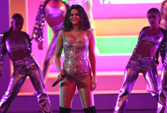 Selena Gomez performs a medley at the American Music Awards on Sunday.
