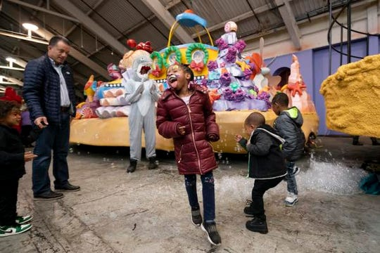Children play in bubbles during the unveiling of the new Art Van Thanksgiving Day parade float, titled, Christmas Under The Sea, at the Parade Company, in Detroit.