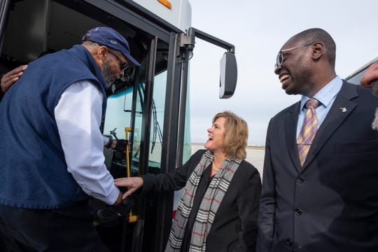 From left, Mass Transportation Authority bus driver John Edmonds chats with Federal Transit Administration Acting Administrator, K. Jane Williams and Michigan Lt. Governor Garlin Gilchrist after a press conference Monday to announce that bus systems in Detroit and Flint will receive $12.8 million in grants to upgrade their service at Detroit Metropolitan Airport.