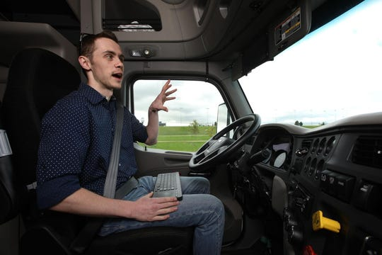 Krystian Gebis, co-founder and CEO of Autobon AI, sits in the driver's seat with no hands on the steering wheel as the 18-wheeler semi-trailer truck autonomously drives around the outside of the Chicagoland Speedway on Friday, Oct. 4, 2019 in Joliet, Ill.