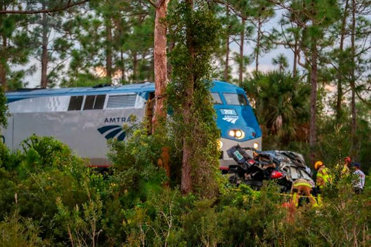 The scene where an Amtrak passenger train hit a car on the tracks in Palm Beach County Saturday, Nov. 23, 2019. Authorities say three people -- a grandmother and her two grandsons -- but no passengers aboard the train were hurt.
