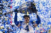 Winnipeg Blue Bombers' Adam Bighill celebrates winning the 107th Grey Cup against the Hamilton Tiger-Cats Sunday in Calgary, Alberta, Sunday