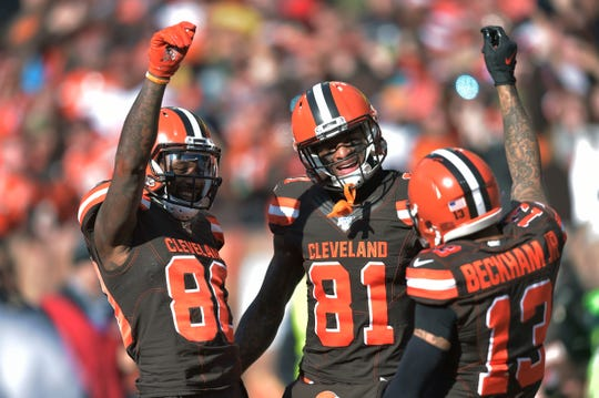 Cleveland Browns wide receiver Jarvis Landry (80) celebrates with Cleveland Browns wide receiver Odell Beckham Jr. (13) and wide receiver Rashard Higgins (81) after Landry scored a 7-yard touchdown during the first half.