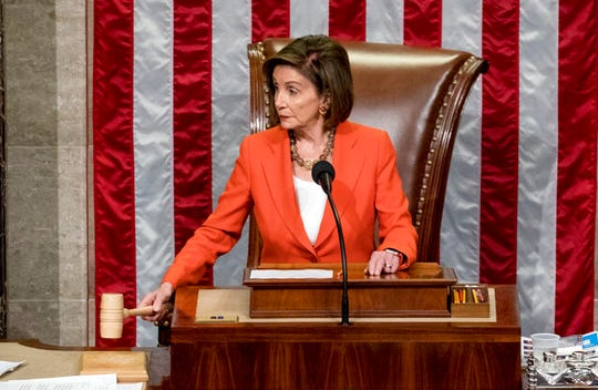 House Speaker Nancy Pelosi of Calif. gavels a vote on impeachment procedure in this Oct. 31, 2019, file photo.