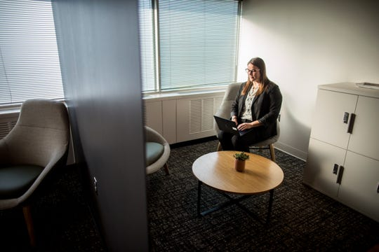 Sara Robertson, a finance manager at Ford Motor Company and mother to a three-year-old and a one-year-old, sits in the seating area of a new mother's room at Ford's World Headquarters in Dearborn. Ford plans to install 77 mother's room at its facilities over the next three years.