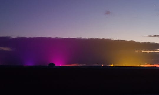 Purple, pink and yellow lights color the horizon as the sun goes down a few miles southeast of Leamington, Ontario.