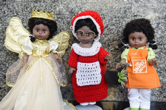 The winners of the 2019 Old Newsboys' Goodfellow Fund doll-dressing contest: First place, Mrs. Claus, center, by Aileen Maga; second place, Home Depot Associate, by Terrie Hylton, right; third place, Angel, by Clayella Webster.