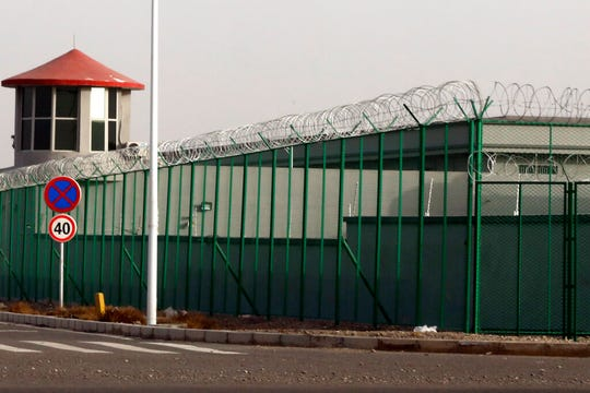 In this Monday, Dec. 3, 2018, file photo, a guard tower and barbed wire fences are seen around a section of the Artux City Vocational Skills Education Training Service Center in Artux in western China's Xinjiang region.