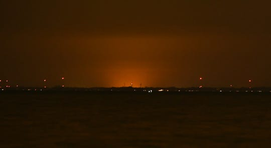 A glow in the sky from greenhouses in Leamington, Ontario, can be seen across Lake St. Clair from Grosse Pointe.