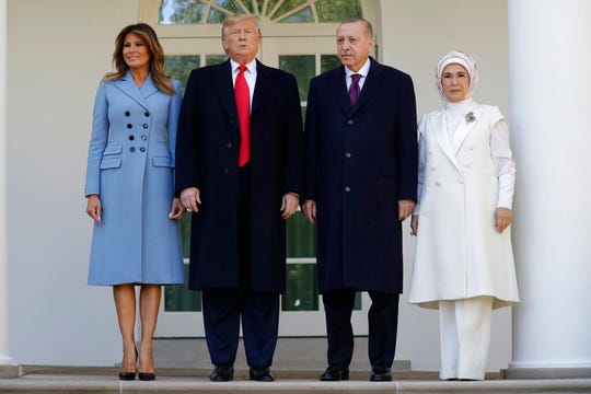 President Donald Trump and first lady Melania Trump stand for photographs with Turkish President Recep Tayyip Erdogan and his wife Emine Erdogan before a meeting in the Oval Office of the White House, Wednesday, Nov. 13, 2019, in Washington.