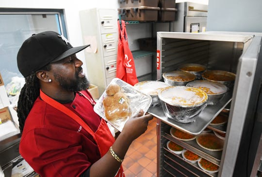 Chef Shaune Fairley gets a lunch of chili and sides for a class of 2 and 3 years at Starfish Family Services.