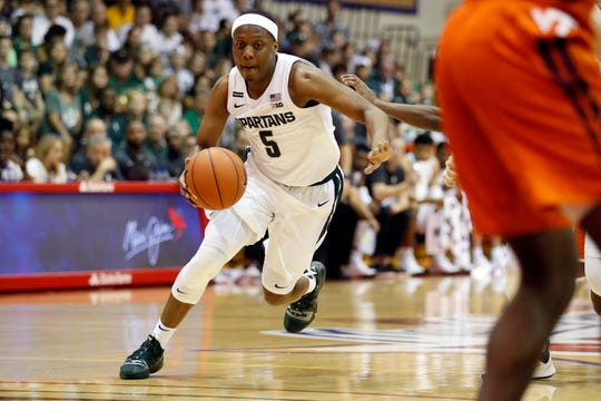 Michigan State guard Cassius Winston  dribbles through the Virginia Tech defense during the first half of their game in the Maui Invitational on Monday, Nov. 25, 2019.