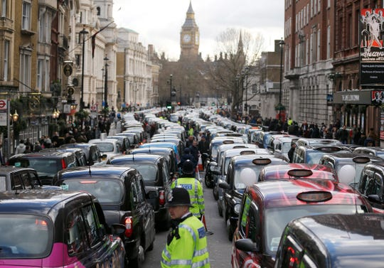 London taxis block the roads during a protest in central London, concerned with unfair competition from services such as Uber.