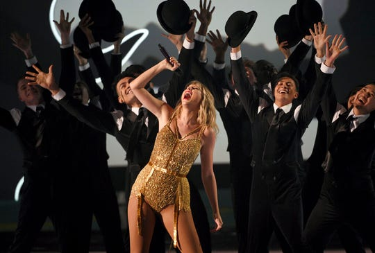 Taylor Swift, winner of the artist of the decade award, performs a medley at the American Music Awards on Sunday.