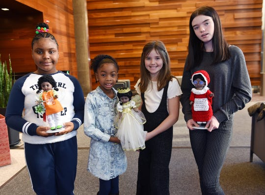 The judges, from left, Aleiya Hogan,10, Ava King, 6, Emily Stanczak, 10, and Natalie Stanczak, 13, hold the winning dolls in the 2019 Old Newsboys' Goodfellow Fund doll-dressing contest.