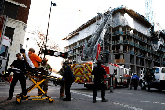 Emergency crews transport a construction worker injured at a partial building collapse in Cincinnati, Ohio, Monday, Nov. 25, 2019.